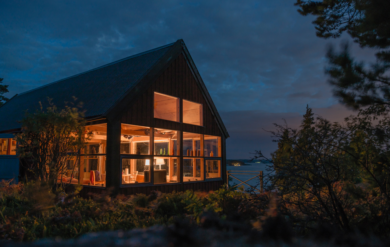 illuminated-house-at-night-BQA8QZC